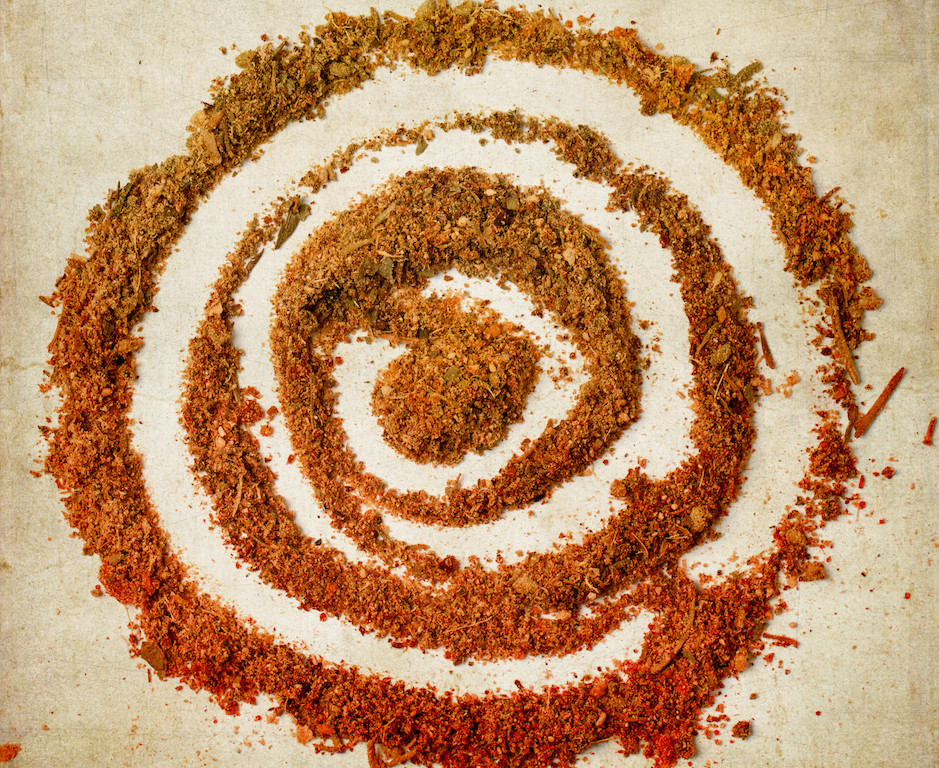 Kapha reducing pungent powdered spices in the shape of a circle labrynth
